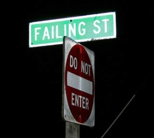 Failing Street sign post